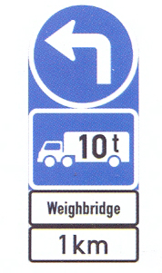 R108-569+IN11.4+IN11.3: Turn Left, Goods Vehicle Over Indicated GVM, Text Message, A Distance Ahead