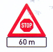 "W302+IN11.3: Traffic Control ""Stop"" Ahead, A Distance Ahead"